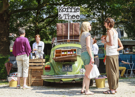 DORDRECHT, NETHERLANDS - AUGUSTUS 10, 2014: Selling coffee and tea out of a car at the summer Swan Market in Dordrecht. The lifestyle market was originally started in vacant shops in Rotterdam Editorial