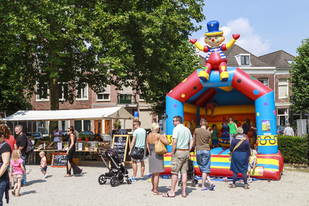 playing the market: DORDRECHT, NETHERLANDS - AUGUSTUS 10, 2014: Parents with children playing at the Swan Market in Dordrecht. The lifestyle market was first held in Rotterdam in the winter of 2010 and known for its fun