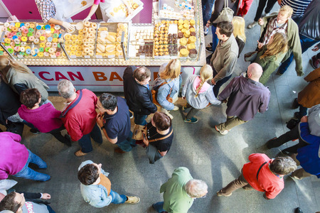 ROTTERDAM, NETHERLANDS - OCTOBER 19, 2014: Looking down on people shopping in the newly openend Markthal. The Market Hall is the first covered market floor in the Netherlands and the largest in Europe Editorial