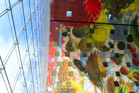 ROTTERDAM, NETHERLANDS - OCTOBER 19, 2014: Vibrant colors on the ceiling of the new Markthal. The Market Hall is the first covered market floor in the Netherlands and the largest in Europe. Editorial