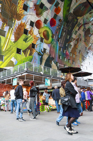 ROTTERDAM, NETHERLANDS - OCTOBER 19, 2014: Shoppers in the newly openend Markthal in Rotterdam. The Market Hall is the first covered market floor in the Netherlands and the largest in Europe.