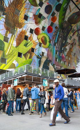 ROTTERDAM, NETHERLANDS - OCTOBER 19, 2014: People shopping in the newly openend Markthal. The Market Hall is the first covered market floor in the Netherlands and the largest in Europe.