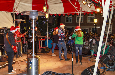 DORDRECHT, NETHERLANDS - DECEMBER 13, 2013: Music entertainment on stage at Stadhuisplein at the Christmas Market in Dordrecht. The market is the largest and busiest X-mas market in Holland.