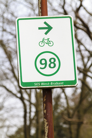 Dutch bicycle route sign pointing right for route 98 in Brabant in the Netherlands