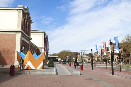 DORDRECHT, THE NETHERLANDS – APRIL 17, 2015: Dordrecht central train station decorated with flags in preparation of the king and queens visit to celebrate kings day which is an annual holiday. Editorial