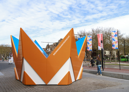 DORDRECHT, THE NETHERLANDS – APRIL 17, 2015: Huge crown is placed in front of Dordrecht central train station in preparation of the king and queens visit to celebrate kings day. Editorial