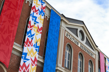 dordrecht: DORDRECHT, THE NETHERLANDS – APRIL 17, 2015: Dordrecht central train station draped with flags in preparation of the king and queens visit to celebrate kings day which is an annual holiday. Editorial