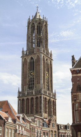 Ancient Dom cathedral towering above the traditional houses in the city center of Utrecht. Editorial
