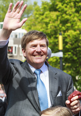 DORDRECHT, THE NETHERLANDS - APRIL 27, 2015: King Willem-Alexander of The Netherlands during his visit to Dordrecht on the traditional Kings Day celebrations together with the Dutch royal family. Editorial