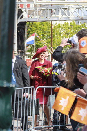 orange nassau: DORDRECHT, THE NETHERLANDS - APRIL 27, 2015: Queen Maxima of the Netherlands greeting the public during her visit to Dordrecht on the traditional Kings Day celebrations.