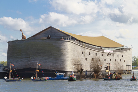 national holiday: DORDRECHT, THE NETHERLANDS - APRIL 27, 2015: Flotilla of ships including a replica of Noahs Ark on the Oude Maas river by Dordrecht in celebration of Kings Day, a national holiday in the Netherlands. Editorial