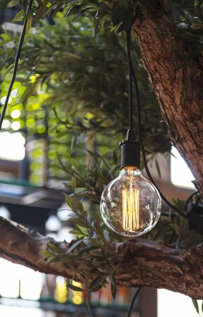 Interior lighting decoration light bulb with bokeh effect in cafe