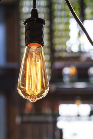 electric bulb: Interior lighting decoration with vintage electric light bulb with bokeh effect in background Stock Photo
