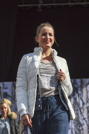 DORDRECHT, NETHERLANDS - SEPTEMBER 27 2015: Free entertainment and fashion show in the main square organized by the municipality. Model walking on the catwalk showcasing the new winter collection. Redakční