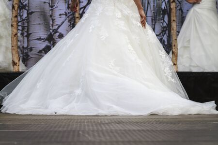 DORDRECHT, NETHERLANDS - SEPTEMBER 27 2015: Entertainment and fashion show in the main square organized by the municipality. Model in wedding dress on the catwalk showcasing the new collection.