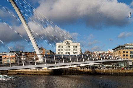 NEWCASTLE, ENGLAND - DECEMBER 7 2014: Crossing the award winning millennium bridge in arts quarter in Newcastle upon Tyne Editorial