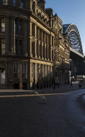 NEWCASTLE, ENGLAND - DECEMBER 7 2014: Sandhill lane with its old limestone buildings and the Tyne Bridge in the background.
