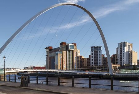 NEWCASTLE, ENGLAND - DECEMBER 7 2014: Baltic Centre for Contemporary Art with millennium bridge in the foreground on the banks of the River Tyne. Editorial