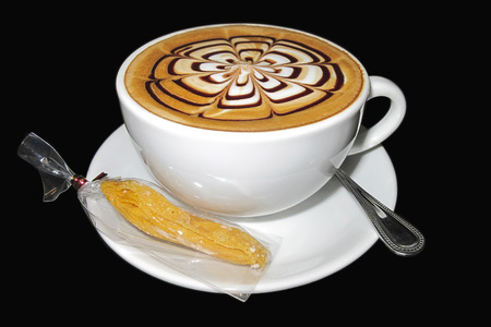 Perfect cafe latte cappuccino with cookie and spoon on saucer Stock Photo