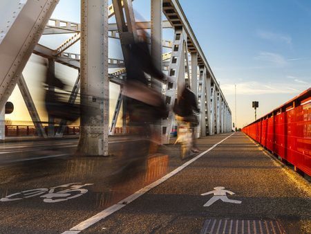 Crossing the bridge by bike in the evening sun between Dordrecht and Zwijndrecht.