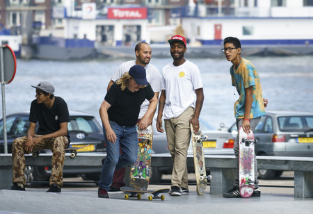 DORDRECHT, NETHERLANDS - 3 SEPTEMBER 2016: Skateboarders hanging out at the official opening of the new skateboard park in Dordrecht.