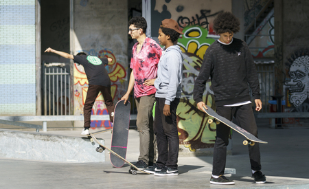 DORDRECHT, NETHERLANDS - SEPTEMBER 3 2016: Group of young skateboarders hanging out at the official opening of the new skateboard park in Dordrecht. Editorial