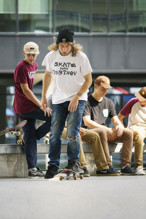DORDRECHT, NETHERLANDS - 3 SEPTEMBER 2016: Skateboarders hanging out at the official opening of the new skateboard park in Dordrecht as one starts his run. Editorial