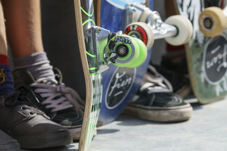 DORDRECHT, NETHERLANDS - 3 SEPTEMBER 2016: Close-up of skateboard wheels and feet as teens hang out at the official opening of the new skateboard park in Dordrecht. Editorial