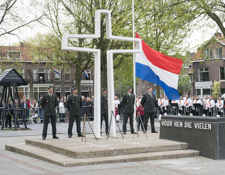 DORDRECHT - THE NETHERLANDS - MAY 4 2017: Dutch soldiers standing to attention at the war monument on Sumatraplein on the National Remembrance Day in Dordrecht.