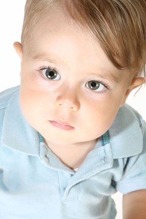 1 year old: Adorable 1 year old boy close up.  Great detail in eyes and skin.