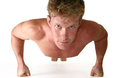 thirty something: Attractive thirty something man doing push ups over white.