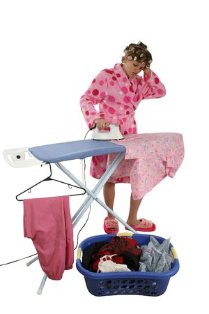 House wife in robe and rollers doing laundry over white