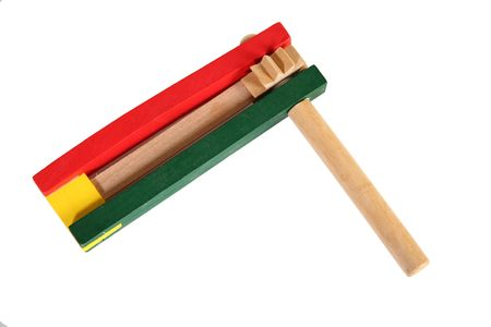 noise maker: Green and Red wooden party favor noise maker. Stock Photo
