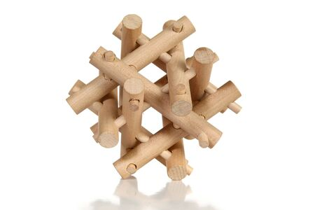 eq: Wooden puzzle over white background.