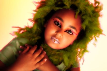 Beautiful ten year old african american girl in artsitic make-up.