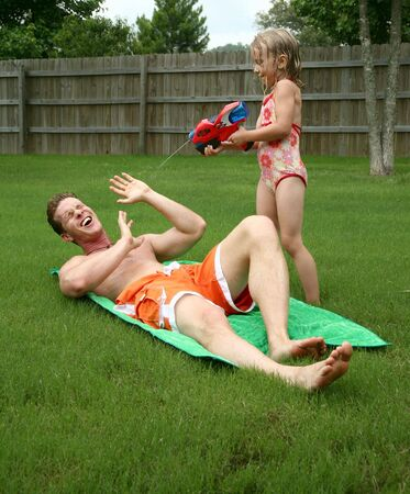 6 7 year old: Backyard water fun with dad and daughter