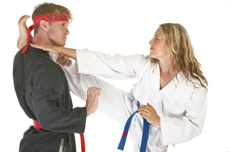 martial arts woman: Martial arts man and woman fighting