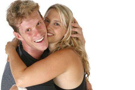 thirty something: Thirty something caucasian couple hugging and smiling.