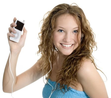 Beautiful teen girl with digital music player. Standard-Bild