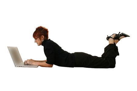 Beautiful thirty something woman in black on laptop photo