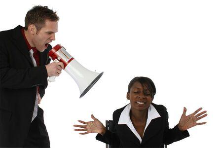 Boss yelling at employee thorugh megaphone /  bullhorn.  Over white. Stock Photo - 2016907