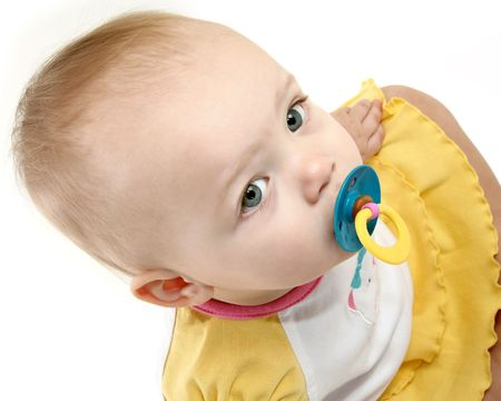 Beautiful 14 month old baby girl close up with pacifier. photo