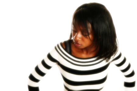 Beautiful African American woman upset or flustered.  Black and white striped sweater over white. Stock Photo - 2272966
