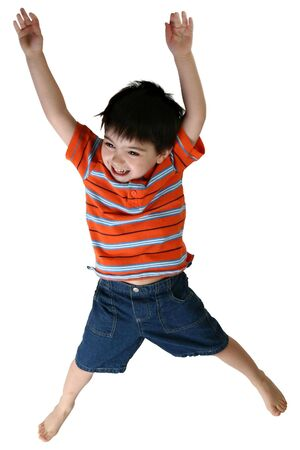 happy four year old boy jumping over white