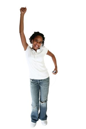 13 15 years: Beautiful African American teen girl dancing to digital music player over white background.