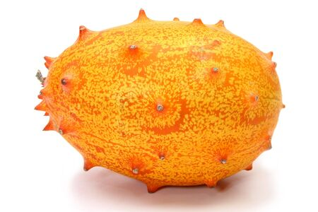 hedged: Kiwano or African horned melon sliced open over white. Also known as hedged gourd, African Horned Cucumber, English tomato.