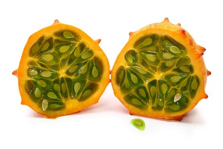 horned: Kiwano or African horned melon sliced open over white. Also known as hedged gourd, African Horned Cucumber, English tomato.