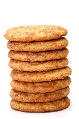 Stack of snickerdoodles over white.