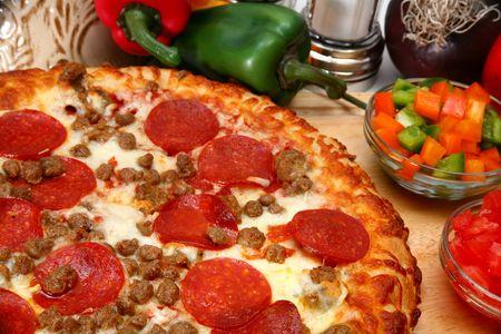 close up of homemade sausage and peperoni pizza Stock Photo