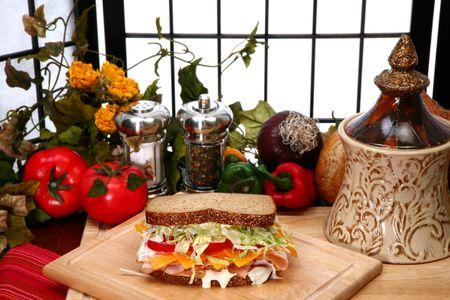 multi grain sandwich: Fresh turkey sandwich with honey rosted deli turkey, shredded lettuce, cheddar cheese, tomatoes and ranch dressing on whole wheat.